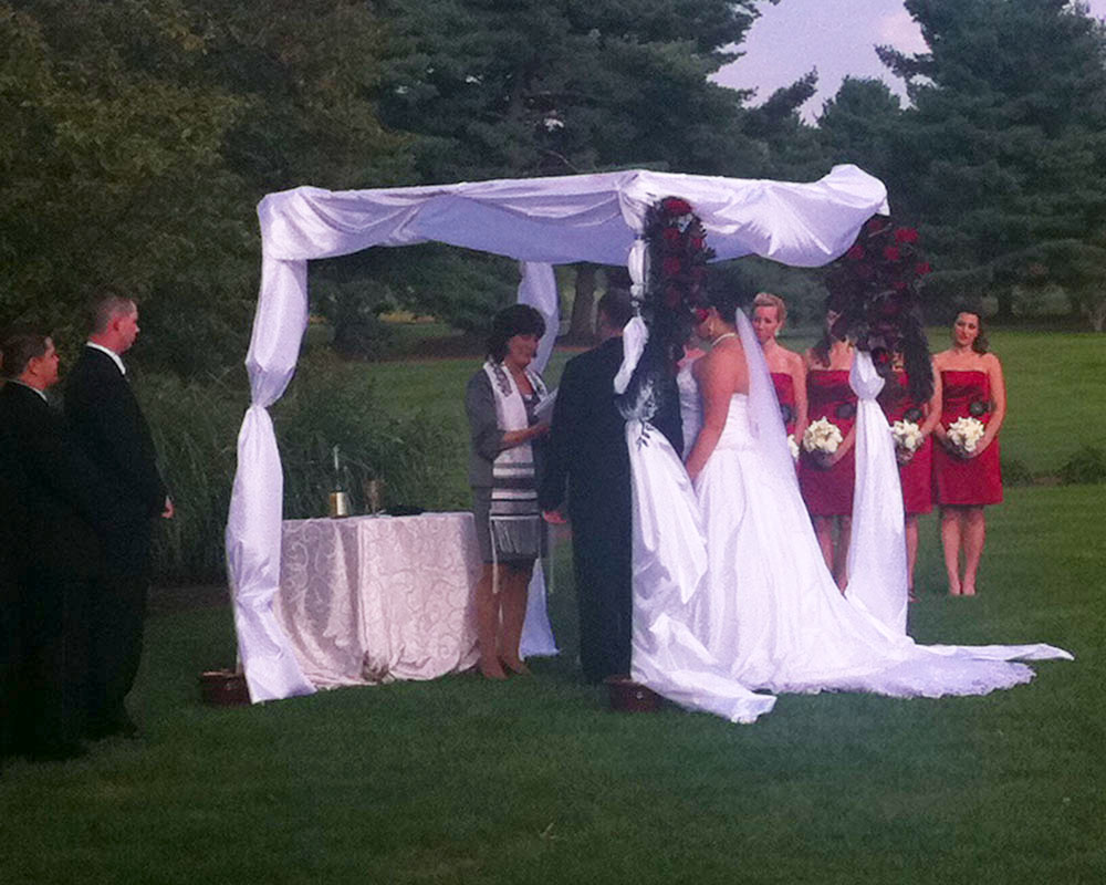 Beth and Adam's beautiful ceremony, outside at the International Country Club