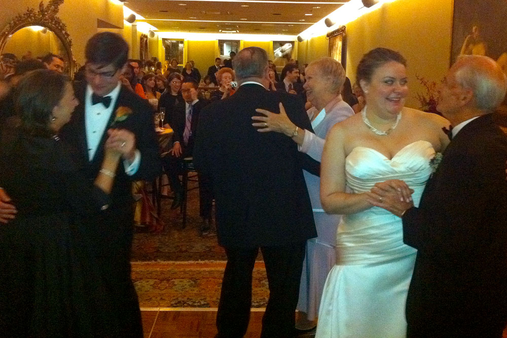 Maureen and Jason dance with their parents to Louis Armstrong