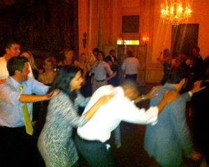 A congo line breaks out near the end of the night at Diana & John's wedding