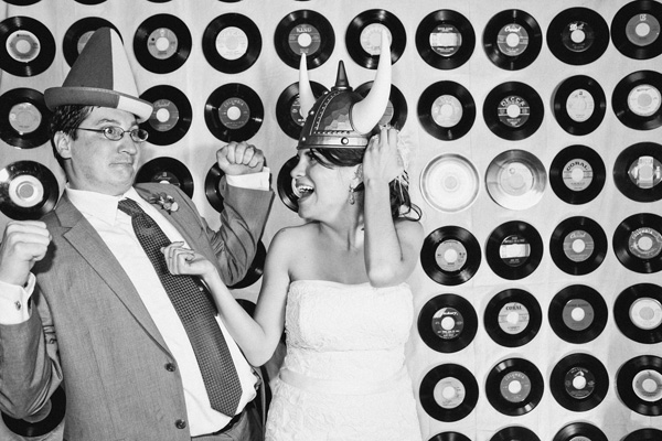 The happy couple hams it up in the vinyl-centric photo booth